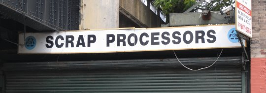 Photograph of a shop with sign scrap processors