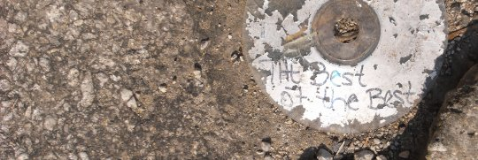 Photograph of a CD laying on the ground